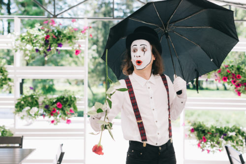 Mime with suspenders and umbrella